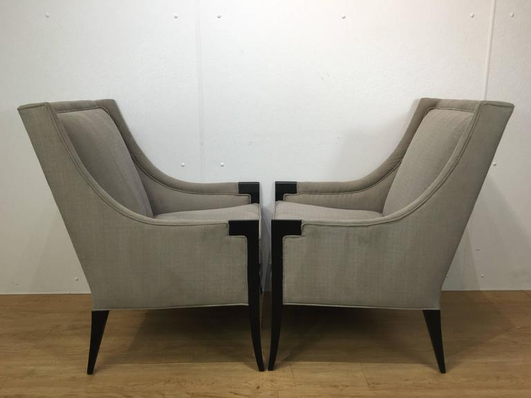 A pair of attributed Edward Wormley for Dunbar chairs newly upholstered in neutral grey fabric with ebonized frames.