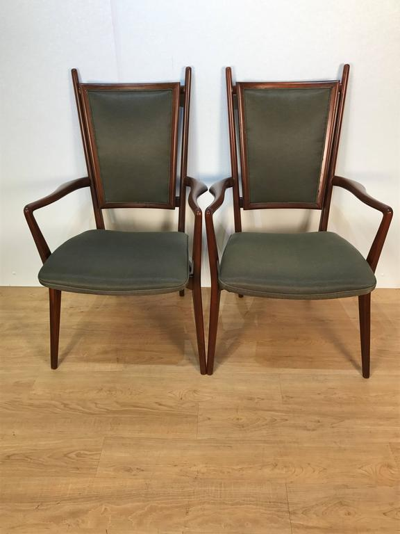 Four Vladimir Kagan dining chairs, by Grosfeld House  consisting of two-arm and two side chairs, newly upholstered. Illustrated with cane seat backs in The Complete Kagan, Tom Ford pages 108 & 109.  Armchairs: 39.5 in H x 24 in W x 24 in D x 25 in
