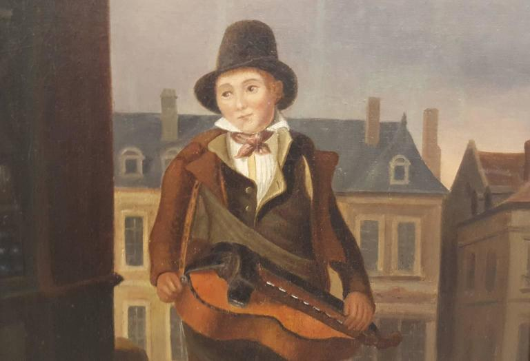 A small oil painting in excellent condition with canvas remounted. It is framed in a gold leafed frame, perhaps the original. It is signed by the artist on the lower left, however the painter's name is illegible. The subject is of a musician on a