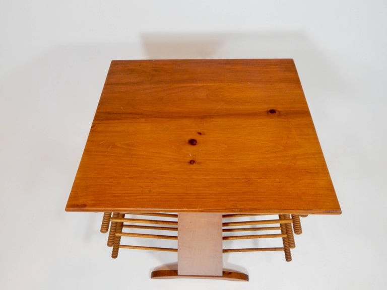 1950s magazine table. Four racks on each side to hold plenty of magazines or newspapers. Table surface makes this a dual purpose and functional piece.