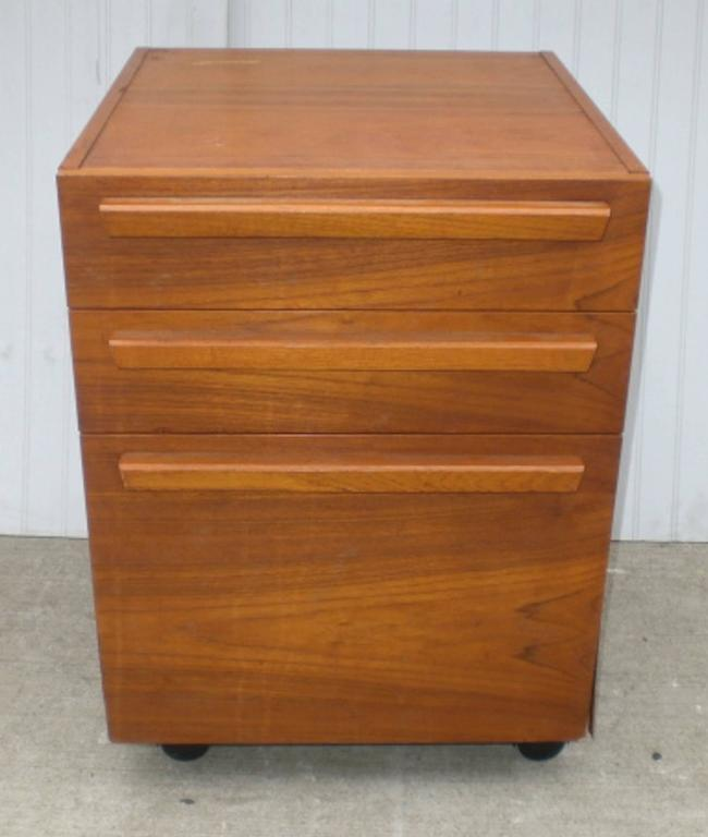 Vintage file cabinet with teak wood grain on casters. Features three  drawers and sculpted handles - Teak File Cabinet On Wheels For Sale At 1stdibs