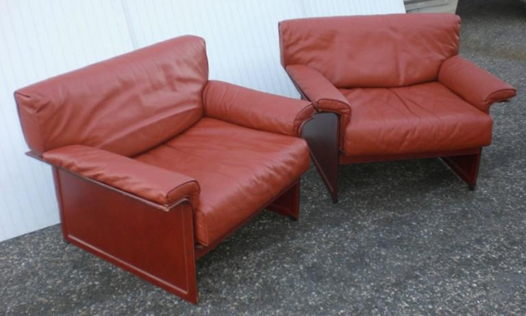 Pair of leather armchairs with leather frame. Very comfortable lounge chairs.  (Please confirm item location - NY or NJ - with dealer).