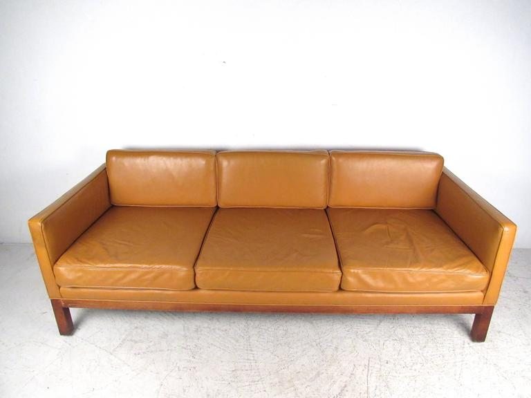 This beautiful vintage sofa offers a wonderful mix of modern style and timeless comfort. WithBørge Mogensen style design, hardwood frame and spacious seating for any interior, this Mid-Century couch is the perfect solution for home or business.