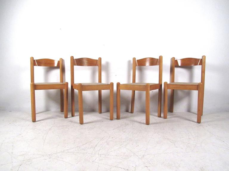Beautiful set of four Italian modern dining chairs features rush seats and curved backs. Unique chairs for any setting, please confirm item location (NY or NJ).
