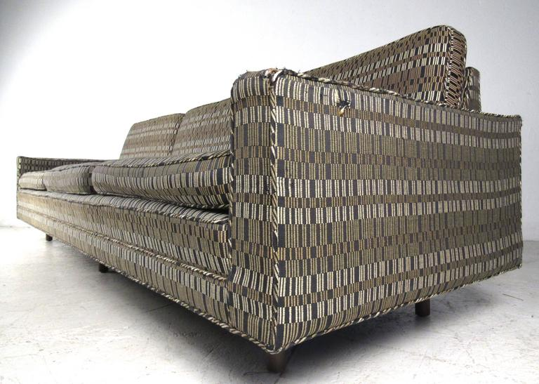 This gorgeous oversized sofa by Harvey Probber offers a stylish and comfortable seating option for any interior. Vintage fabric, quality six leg construction, and unique low profile design add to it's Mid-Century charm. Please confirm item location