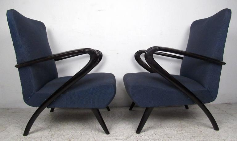 Stylish pair of vintage modern Italian armchairs make an elegant mid-century addition to home or business lounge or salon seating. The sculptural lacquered arms and seat back offer timeless comfort and the iconic style after Paolo Buffa.  Please