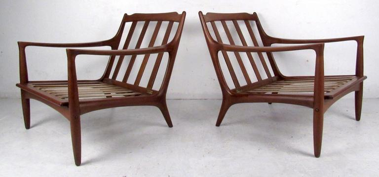 Danish Pair of Sculpted Mid-Century Lounge Chairs For Sale