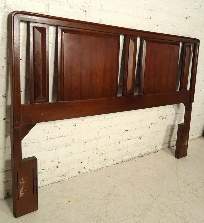 Vintage-modern headboard featuring beautifully sculpted back and walnut wood grain throughout.  Please confirm item location NY or NJ with dealer.