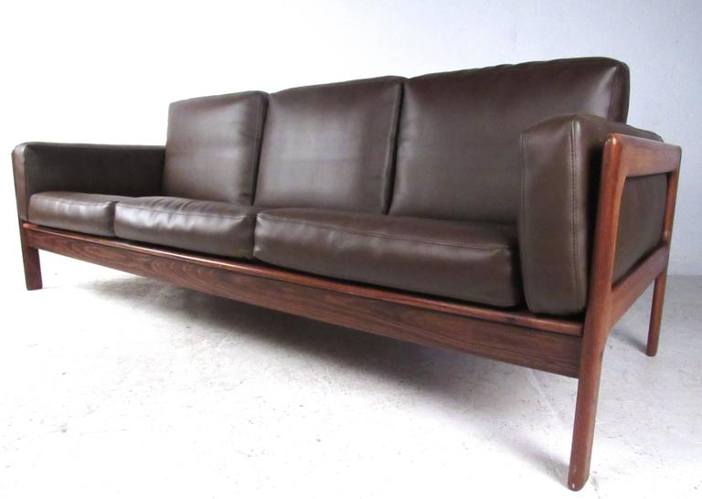 This Beautiful Vintage Sofa Features A Deep Rosewood Finish Quality Vinyl Upholstery And Sleek