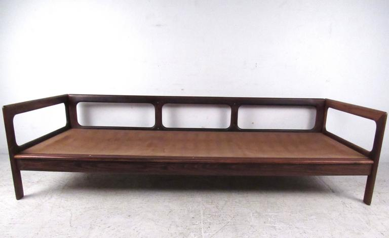 Faux Leather Mid-Century Rosewood Sofa by Komfort For Sale