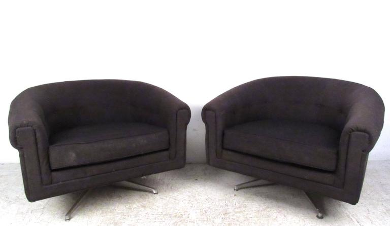 American Pair of Mid-Century Style Swivel Lounge Chairs by Selig For Sale