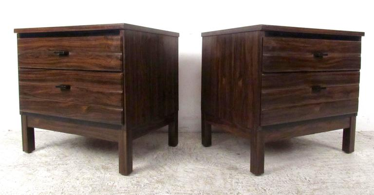 Two vintage-modern nightstands featuring two drawers each and beautiful rosewood grain, manufactured by American of Martinsville.  Please confirm item location NY or NJ with dealer.