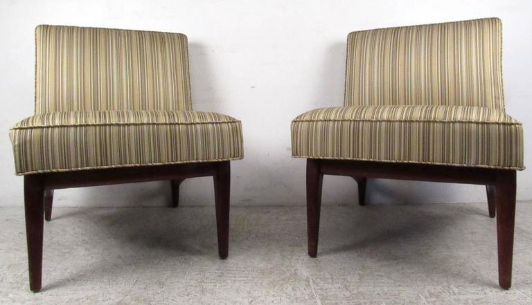Two vintage-modern walnut slipper chairs with upholstered seat and back, designed in the manner of Jens Risom. This stylish and comfortable set of chairs with tapered legs and thick padded seating makes the perfect addition to any seating