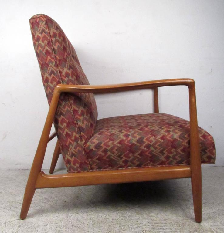 Vintage-modern lounge chair featuring sculpted legs and armrests with upholstered seat and back, designed in the manner of Adrian Pearsall.  Please confirm item location NY or NJ with dealer.