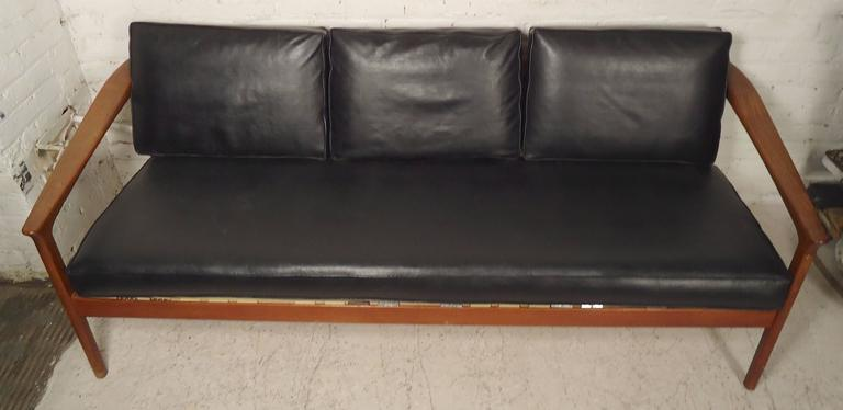 Beautiful Mid-Century Modern sofa by DUX with great sculpted teak frame. Vinyl cushions, exposed slat back, tapered legs. Great Danish style and design.  (Please confirm item location - NY or NJ - with dealer).
