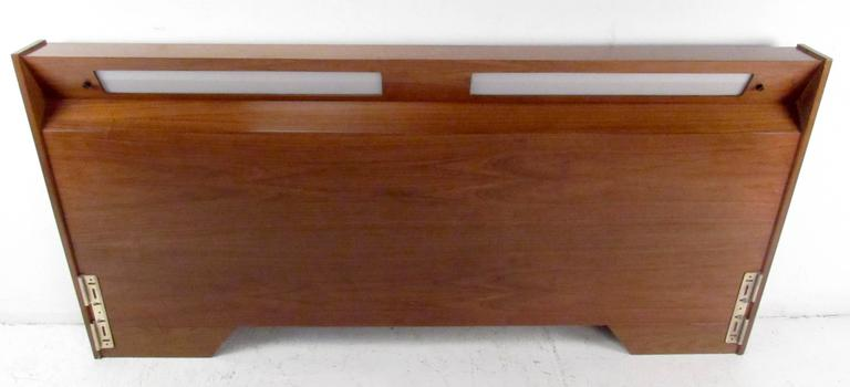 Mid-century modern headboard featuring rich walnut wood grain, impressive king size headboard perfect addition to any bedroom setting.  Please confirm item location NY or NJ with dealer.