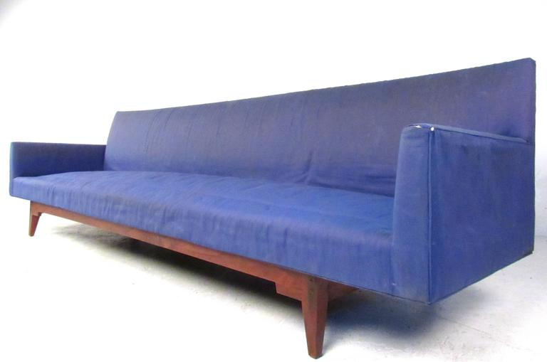 This large-scale sofa measures over 9 feet long and makes a unique and stylish seating addition to any interior. Comfortable and stunning in it's size and simplicity, the design by Jens Risom's