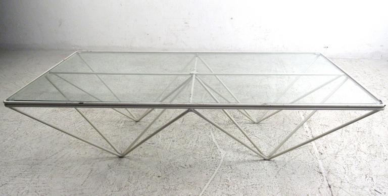 The unique modern design of Paolo Piva sets apart this metal frame geometric coffee table, making it a visually impressive addition to any seating area. Please confirm item location (NY or NJ).