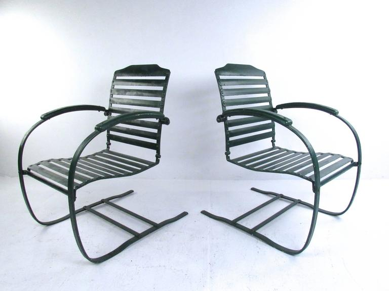 This Vintage Pair Of Patio Chairs Features Sy Metal Construction With Horizontal Slat Seat And Back