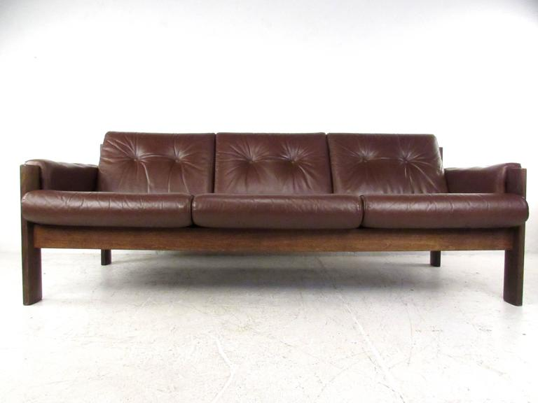 this mid century modern tufted leather sofa is no longer available