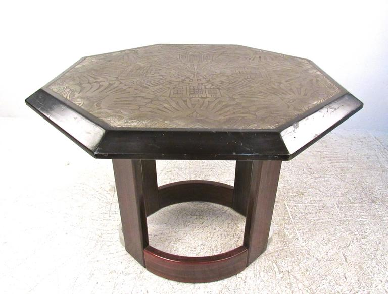 This unique Italian table features an impressive raised design top with unique design. Whether on display in the foyer, sitting room, or entryway this octagonal center table with stylish pedestal base makes an impressive addition to any setting.