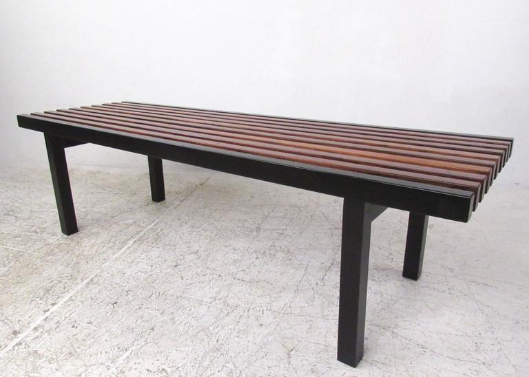 This stunning vintage slat bench features unique two-tone finish with black lacquered trim and rich rosewood finish throughout. Sturdy and perfect for use as occasional seating or as a coffee table. Please confirm item location (NY or NJ).