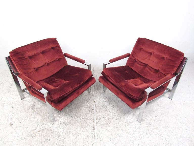 This Mid-Century Modern pair of matching chrome armchairs features the distinctive style of Cy Mann. The combination of vintage style, heavy chrome construction, padded armrests and plush tufted upholstery make these an impressive addition to any