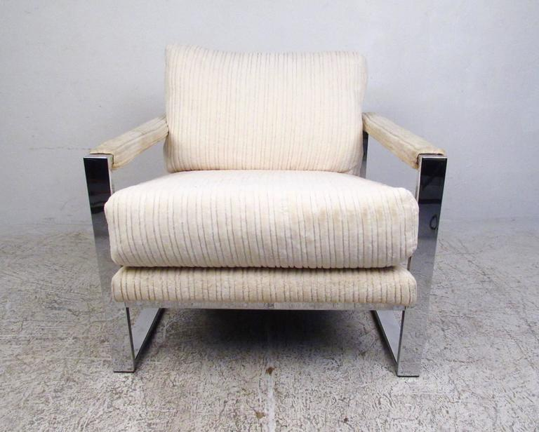 This vintage modern heavy chrome lounge chair features unique Mid-Century design in a comfortable package. Upholstered armrests, plush fabric cushions and lounge style seat design make this an excellent modern addition to home or office. Vintage