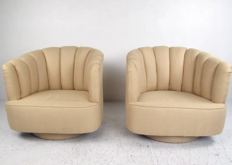 pair of contemporary modern scalloped swivel lounge chairs for sale