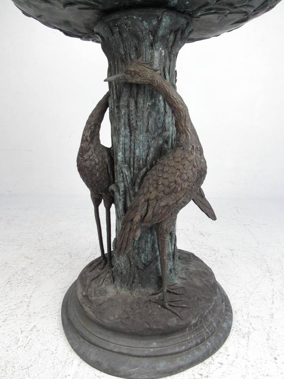This stunning bronze fountain features a wonderfully patinated aviary motif, complete with ornate egrets and elegant details. This unique piece makes a stunning visual impression when in use as a garden water fountain or simply as an ornamental