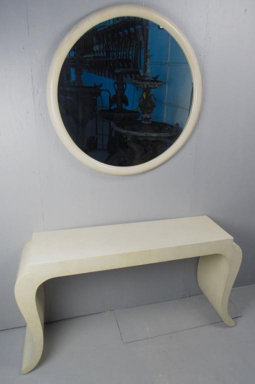 This matching mirror and hall table make a stylish contemporary modern display in any home or business. This stylish vintage table is ideal for hall or entryway use. Two tone cream finish is accented by cut away table top and scrolled legs.  Please