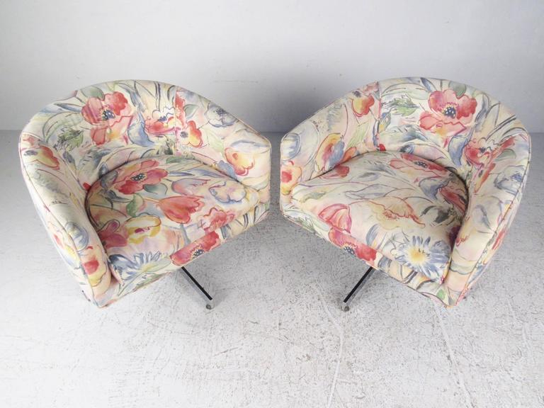 This beautiful pair of vintage swivel club chairs feature the stylish Mid-Century design of Milo Baughman for Thayer Coggin. Unique floral pattern, heavy chrome X bases and comfortable rounded back design make this matching pair an impressive modern