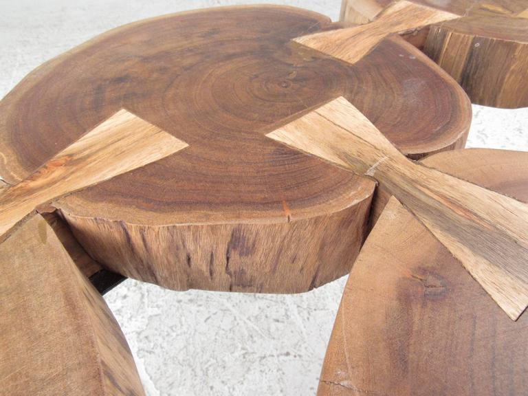 Coffee Table With Six Tree Stump Circles Joined By Bow Tie Joints. Intron  Hair Pin