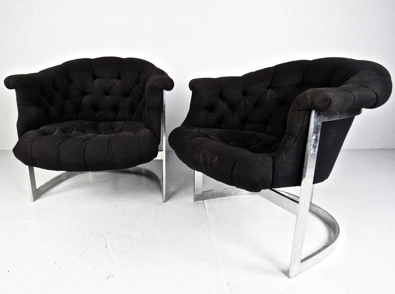 This pair of vintage modern tub style lounge chairs feature the unique barrel back style design of Mid-Century master Milo Baughman. Tufted vintage fabric and stylish sculpted seat backs add to the comfort and charm of the matching pair. Please