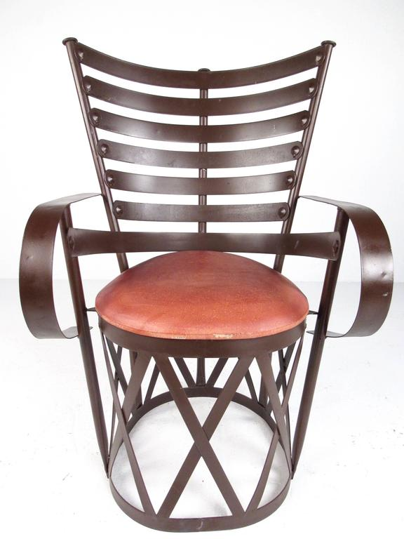 This sculpted metal armchair features comfortable high back design with ornate detail. Uniquely shaped decorator chair offers stylish and comfortable seating for any setting. Please confirm item location (NY or NJ).