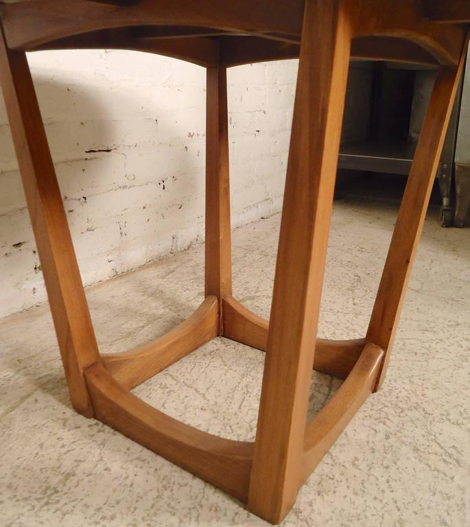 Mid-Century Modern walnut side table with stone insert. Attractive open base and smooth edged top.  (Please confirm item location - NY or NJ - with dealer).