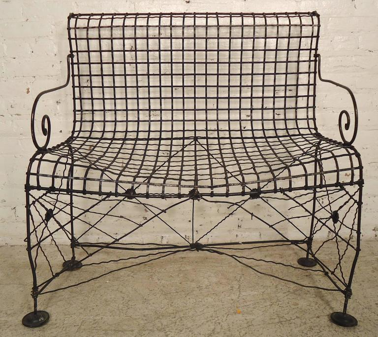 Attractive petite iron bench with scrolled arms and webbed base. Great as lawn furniture.