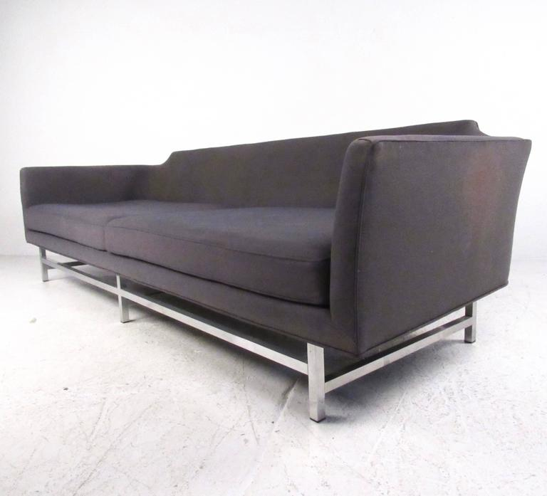 This oversized contemporary modern sofa features Mid-Century style design with unique cutaway back and spacious upholstered seating area. Wonderfully comfortable and long sofa perfect for any seating area. Please confirm item location (NY or NJ).