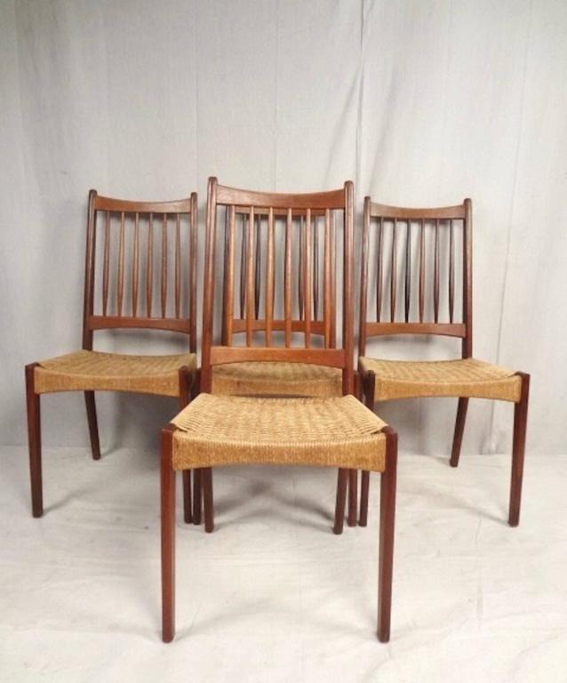This Stylish Set Of Four Spindle Back Dining Chairs Are Constructed From  Vintage Danish Teak In
