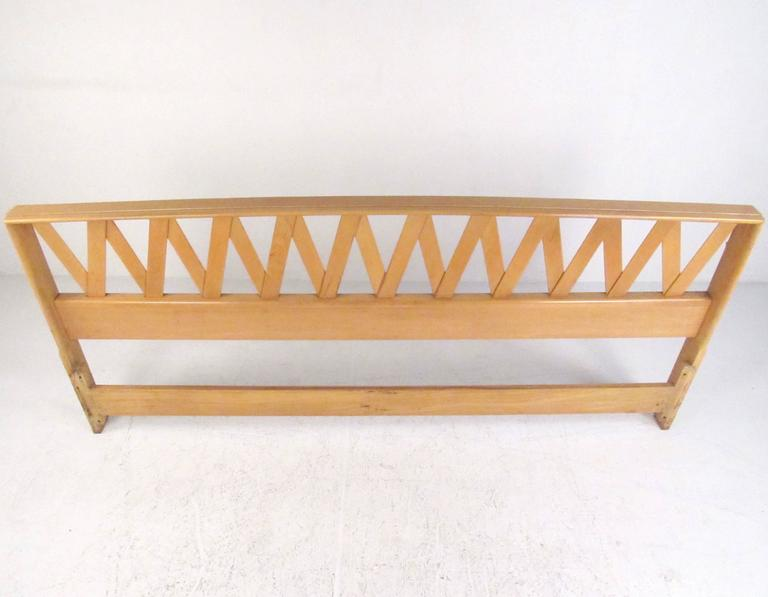 This vintage king-size headboard features the stylish Mid-Century design of Paul Frankl for Johnson furniture. The sculptural design adds unique modern appeal to any bedroom. Please confirm item location (NY or NJ).