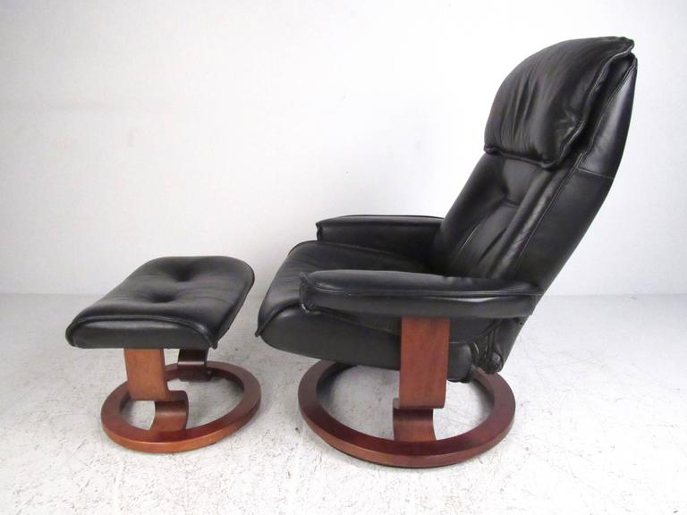 This Stylish Modern Lounge Chair Features Tufted Leather Upholstery Hardwood Swivel Base And Adjule Reclining
