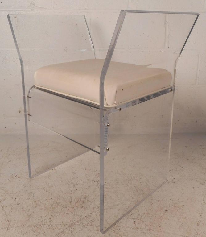 Beautiful vintage modern bench or stool features unusual winged Lucite sides designed for optimal comfort. Elegant white vinyl upholstery covers a thick padded seat. Sturdy and stylish piece makes the perfect eye catching addition to any seating