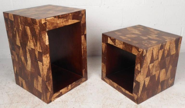 This beautiful vintage modern pair of end tables feature a unique coconut shell inlay design around the exterior. The interior allows room for storage and has gorgeous wood grain to compliment the outside. The larger table has one hidden drawer