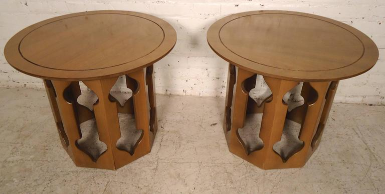 Pair of end tables with round top and sculpted bases in a Harvey Probber style.   (Please confirm item location - NY or NJ - with dealer).