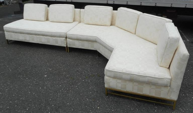 This stunning vintage modern sectional sofa was designed by Paul McCobb for Directional in 1958. Beautiful two-piece design with thick padded cushions and a stylish brass frame. This shapely piece wraps around at the perfect angle ensuring easy