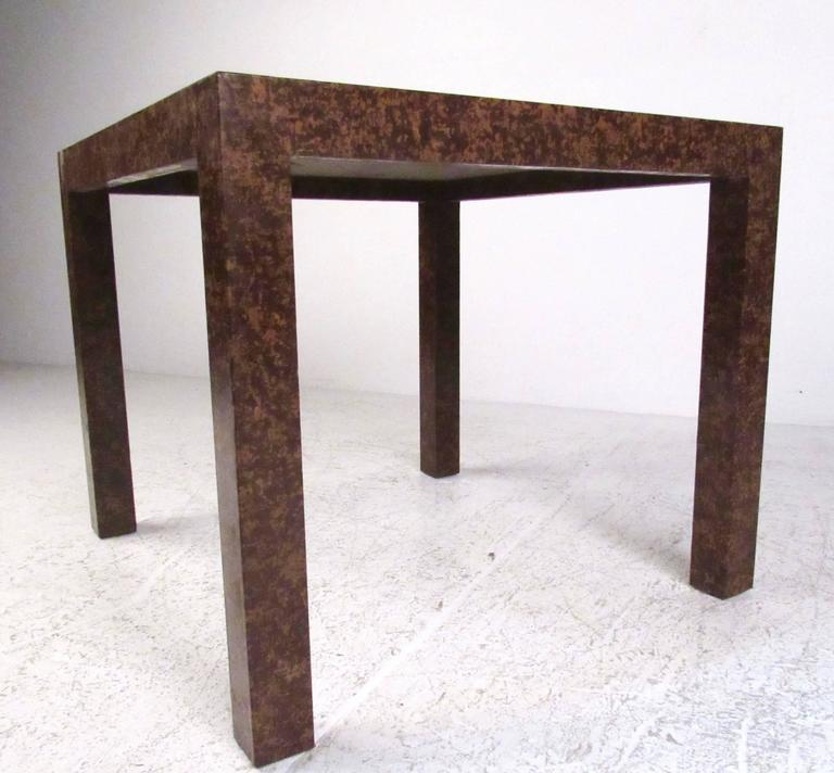 This unique oil-spot lacquered side table features a unique burl-like finish with mid-century modern style design similar to Edward Wormley for Dunbar. Second similar side table (ten inches wider) also available, please confirm item location (NY or