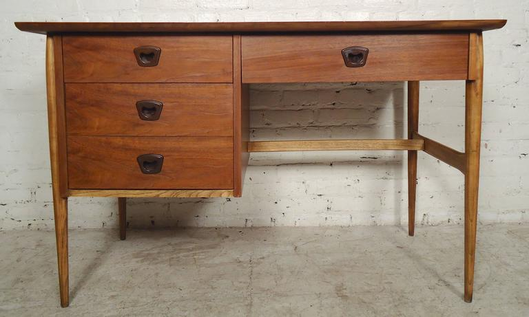 Vintage American desk with walnut grain and oak trim. Three drawers, sculpted legs and curved top.  (Please confirm item location - NY or NJ - with dealer).
