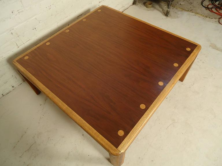 Mid-Century Modern coffee table by Lane with rich walnut grain and oak legs and matching inlay dots.