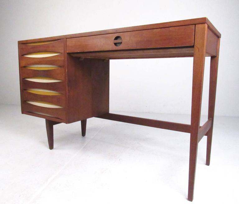 This stylish vintage modern bedroom suite includes four stunning pieces, finished in vintage walnut with unique Arne Vodder style drawer fronts. Matching low dresser, highboy, nightstand, and writing desk make an impressive Mid-Century Modern
