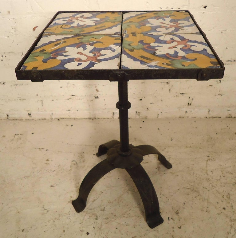 Pretty painted tiles set on an iron base. Great for patio or outdoors.  (Please confirm item location - NY or NJ - with dealer).